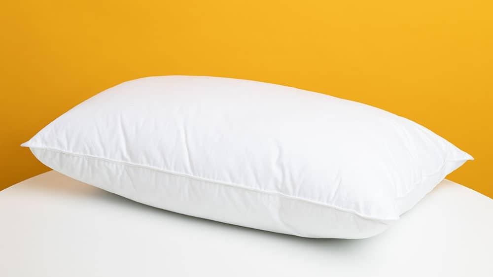Afbeelding van een wit hoofdkussen.